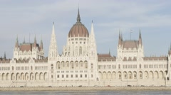 Hungarian parliament building located on river Danube  and city of Budapest Stock Footage