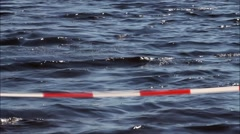 Barrier caution tape on beach, no continuity - stock footage