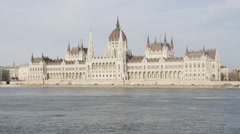 Hungarian parliament building by the day located on river Danube banks UHD Stock Footage