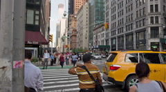 street traffic tilting up to beautiful buildings Midtown Manhattan Broadway NYC - stock footage
