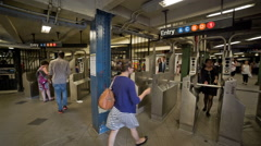 Woman in glasses swiping metro card in subway station NYC Stock Footage