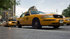 Upward angle from ground - dramatic view of taxicab at taxi stand - yellow cab Stock Footage