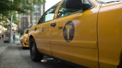Woman opens door of yellow taxi cab near Columbus Circle in New York City Stock Footage
