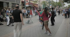 EDITORIAL - People dancing to Latin music on the Third Street Promenade Stock Footage