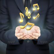 Businessman holding golden music notes Stock Illustration