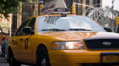 Taxicab driving away from taxi stand, yellow cab drives off  Columbus Circle NYC Stock Footage