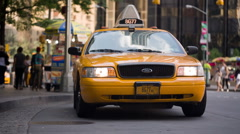 Taxi cab parked with light on, taxicab available at Columbus Circle NYC Stock Footage