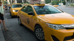 woman getting into taxicab at taxi stand in Columbus Circle NYC - stock footage