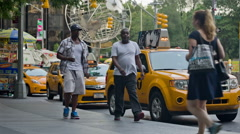 Two black men walking by taxi stand in Columbus Circle NYC Stock Footage