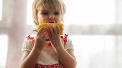 Little girl eat sweet corn Stock Footage