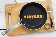 Cookie biscuits word VINTAGE in frying pan - stock photo