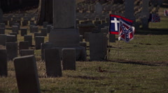 Flags waving at grave stones in cemetery 4k Stock Footage