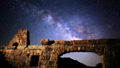 Stock Video Footage of Astrophotography Time Lapse of Milky Way rising over Brick Ruin