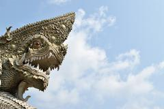 Serpent or naga statue head - stock photo