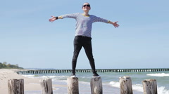 Woman standing on the beach with arms wide open, slow motion HD Stock Footage