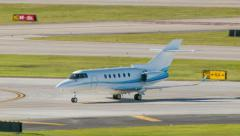 Private Executive Business Jet Airplane Taxiing at Airport Stock Footage