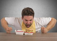 Hungry fat man Stock Photos