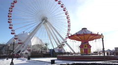 Navy Pier carnival with swings and ferris wheel 4k Stock Footage
