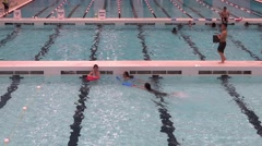 Public Swimming Pool - 24 - Kids Training with Boards Stock Footage