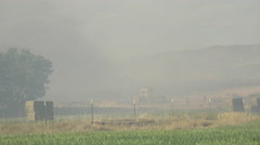 Wildfire rural farms making fire break to control flames 4K Stock Footage