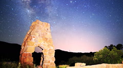 Stock Video Footage of Astrophotography Time Lapse of Milky Way over Arch Ruin -Long Shot-