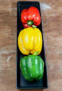 Bell pepper fresh green yellow and red Stock Photos