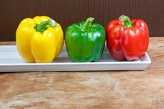 Bell pepper fresh green red and yellow Stock Photos