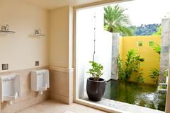 Male toilet with water feature - stock photo