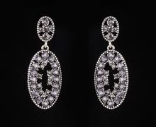 Earrings with jewels on the black Stock Photos