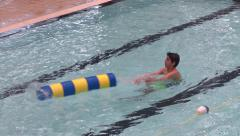 Public Swimming Pool - 26 - Boy with Toy Stock Footage