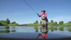 Slow Motion Active Senior Man Fly Fishing Outside in Lake Stock Footage
