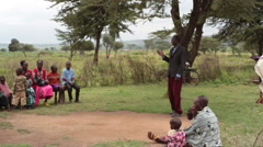 Paster giving sermon in rural village, Samburu, Kenya, Africa, long shot Stock Footage