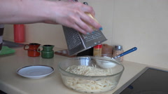 Woman grated cheese on pasta spaghetti. Dinner preparation. 4K Stock Footage