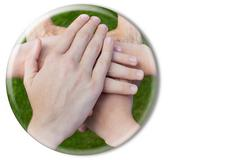 Hands uniting in glass sphere on white Stock Photos