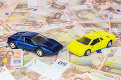 Two model cars on 50 euro bills - stock photo