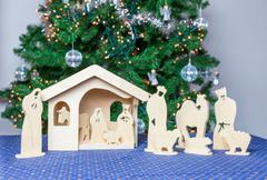 Wooden christmas stable with bible figurines - stock photo