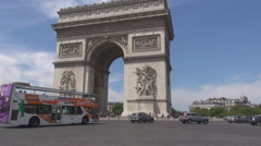 Car tourisic bus in Paris motorcycle drive downtown Arch of triumph intersection Stock Footage