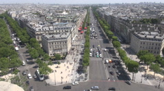 Cars, traffic around arch of triumph in Paris France seen from above, aerial Stock Footage
