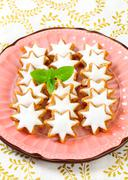 Cinnamon star cookies glazed with frosting - stock photo