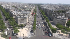 Traffic around arch of triumph in Paris France seen from above, aerial Stock Footage