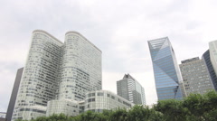 La Defense business zone, green trees in Paris, headquarters, business workers Stock Footage