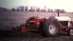1957 - Tractor Digging Trenches For Pipes - stock footage