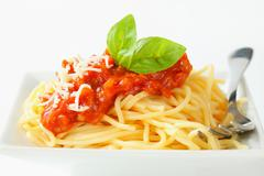 Spaghetti with meat-based tomato sauce and cheese - stock photo