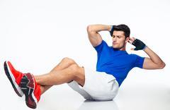 Sports man doing abdominal exercises - stock photo