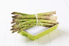 Bundle of fresh asparagus spears - stock photo