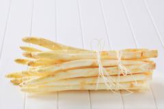 Bundle of fresh white asparagus spears - stock photo