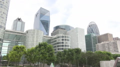 La Defense urban zone in Paris, offices, glass skyscrapers, tower, business, art Stock Footage