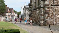 Group of girls walking past old church Stock Footage