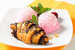 Stock Photo of Chocolate chip crescent rolls with two scoops of ice cream