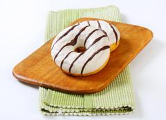Ring donuts with vanilla and chocolate glaze - stock photo
